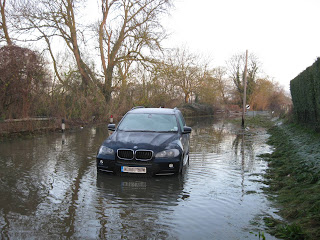 Covering a BMW driver's embarrassment at being stranded in a flood!