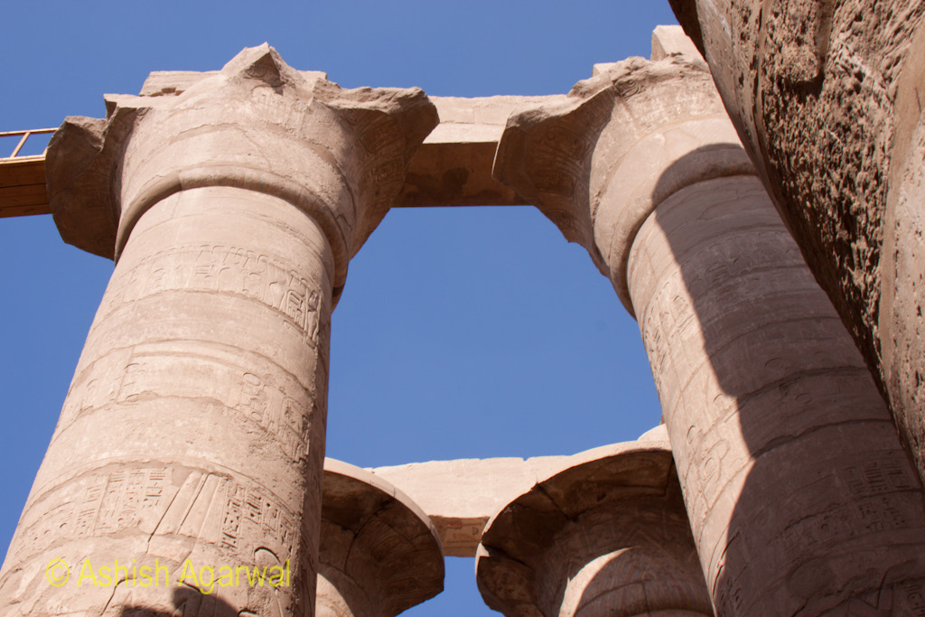 Large pillars along with the architrave on top inside the Hypostyle Hall in the Karnak temple