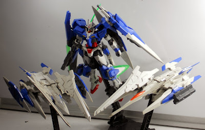 00 Gundam with two XN-Raisers, one with shields, the other with missile boxes