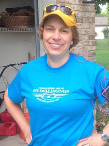 "Dr. Romzick showing off her ""Braces Make Beautiful Faces"" Dr. Jusino t-shirt!"