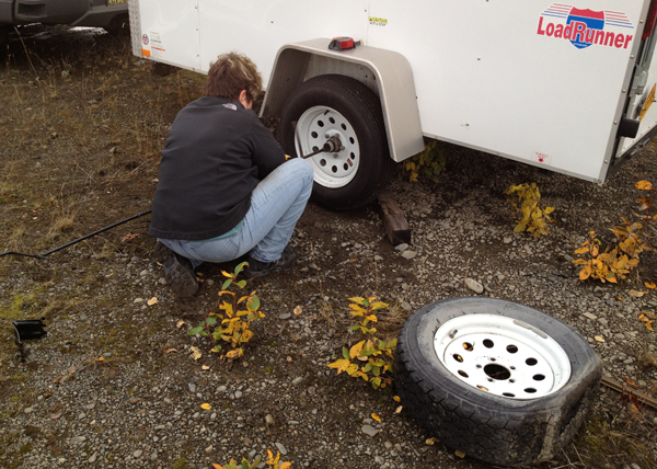 Image of my changing a flat tire on trailer
