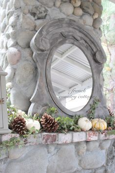 French style gray mirror on fireplace mantel