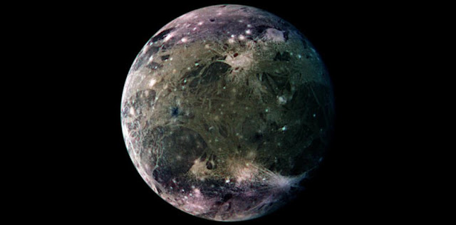 Enhanced-color Galileo spacecraft image of Ganymede's trailing hemisphere. The crater Tashmetum's prominent rays are at lower right, and the large ejecta field of Hershef at upper right. Part of dark Nicholson Regio is at lower left, bounded on its upper right by Harpagia Sulcus. Credit: NASA