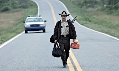 Rick Grimes (Andrew Lincoln) goes in search of gas in the Walking Dead, AMC 2010