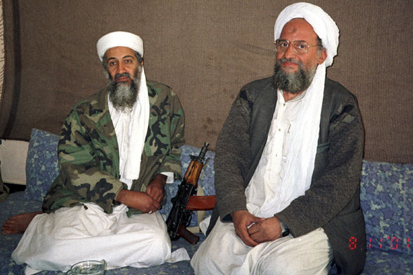 Osama in Laden L sits with. Osama bin Laden (L) sits with