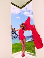 Rosie Huntington Whiteley leggy in a red hot mini dress