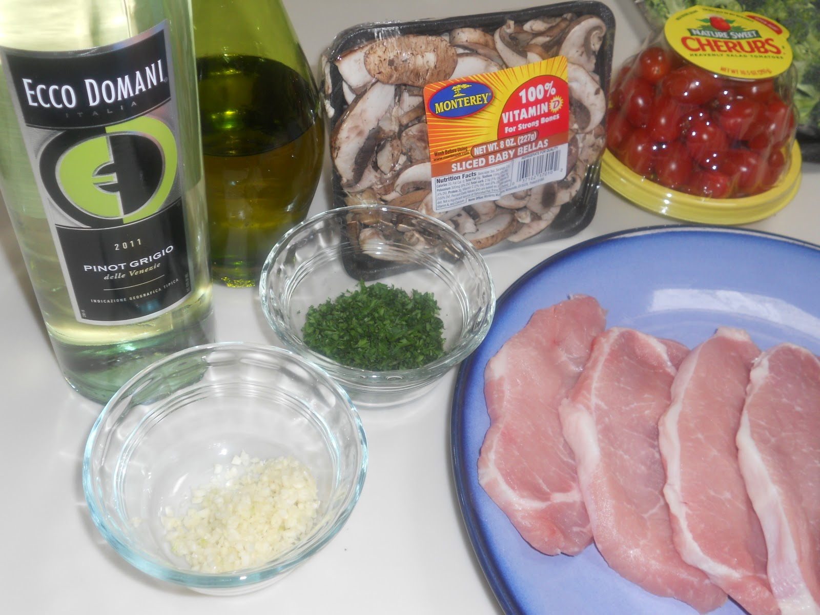 ... -Thyme Life: Pork Chops with a White Wine, Mushroom and Tomato Sauce