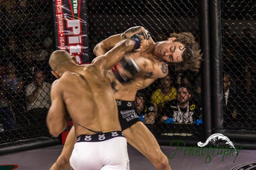 Global Warrior F.C. 2, Kyle Post vs Oliver Vadnais at Burlington Central Arena in Burlington, Ontario on May 30, 2015. Photo: Jeremy Penn / Pennography  NIKON D7100 AF Zoom 17-55mm f/2.8G 1/125, f/2.8 ISO: 1250