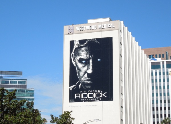 Giant Riddick movie billboard