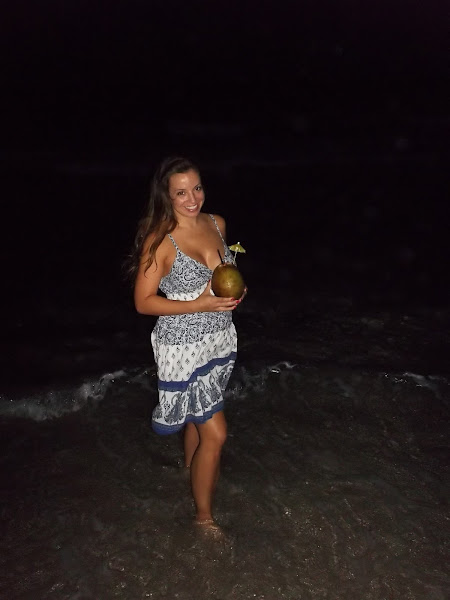On the beach with a coconut full of rum!