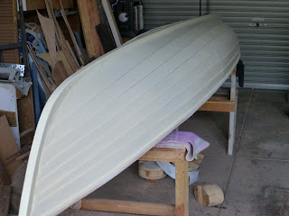 painted canoe hull, first coat