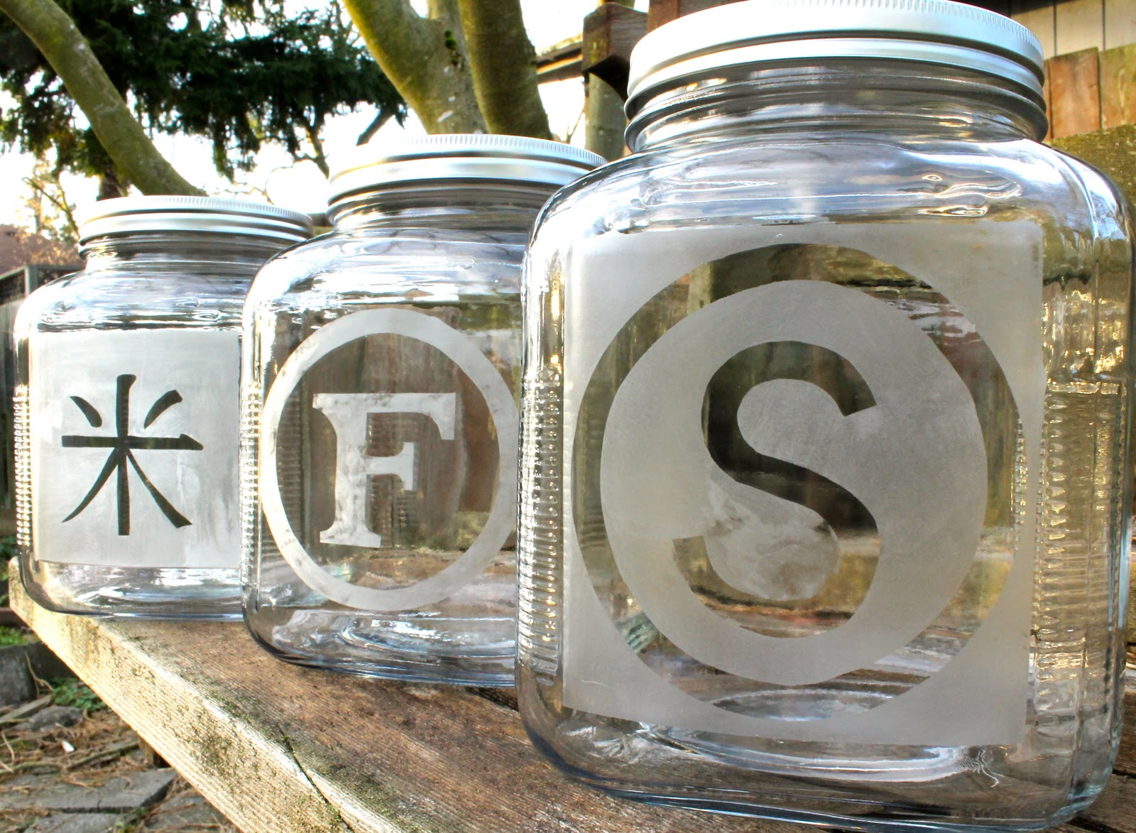 Jars with initials etched into their surface