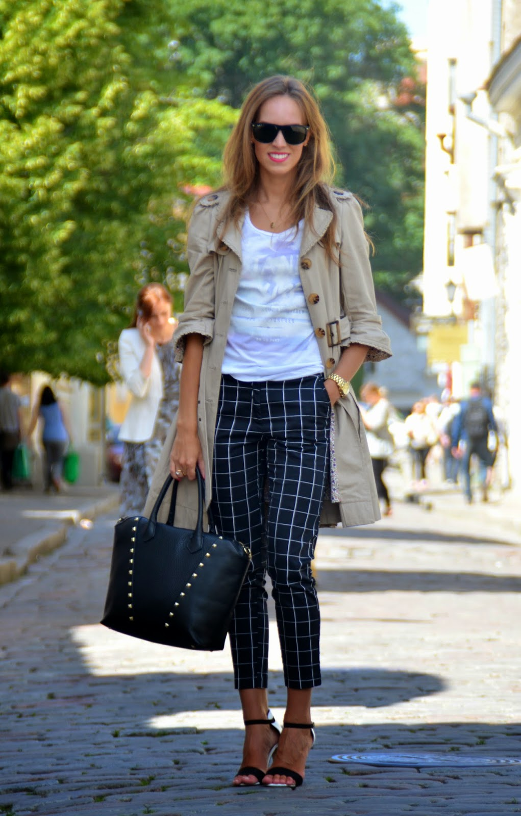 beige oat black pants office outfit