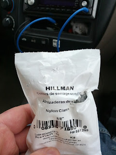 Plastic bag containing Hillman nylon clamps.