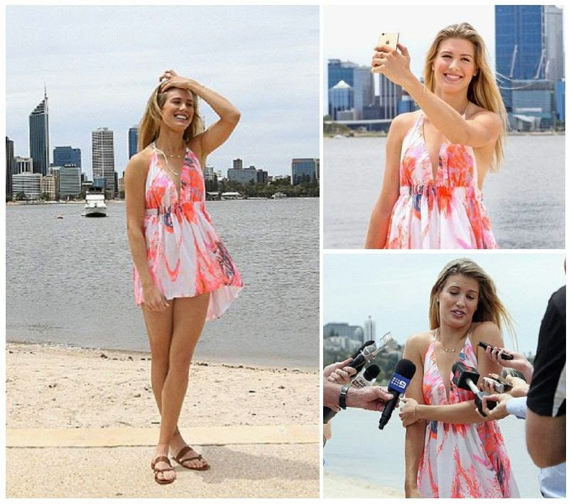 The 20-year-old enjoyed some fresh air at the Swan River beach in Perth WA, Australia on Friday, January 9, 2015 as she put her lean legs on full display in a pink short dress.