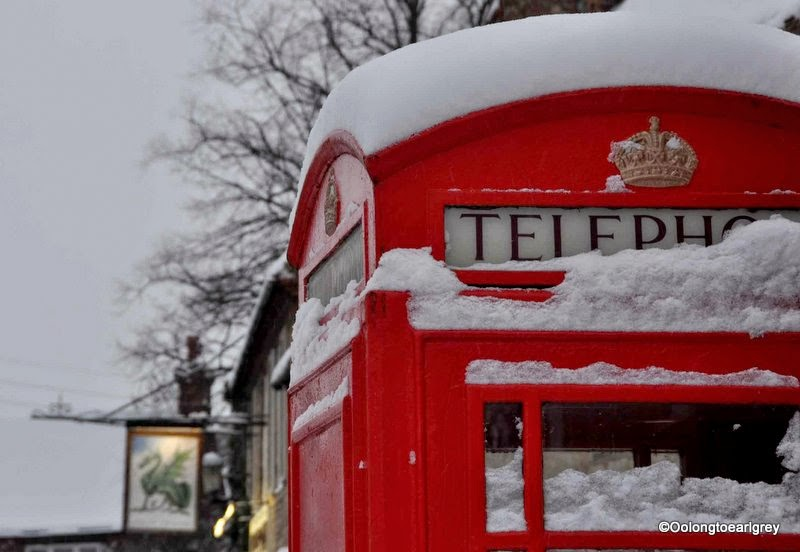 Snow covered red phone box