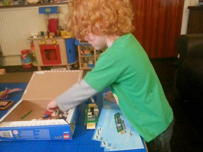 Four year old building LEGO Camper Van set 60057 age 5+
