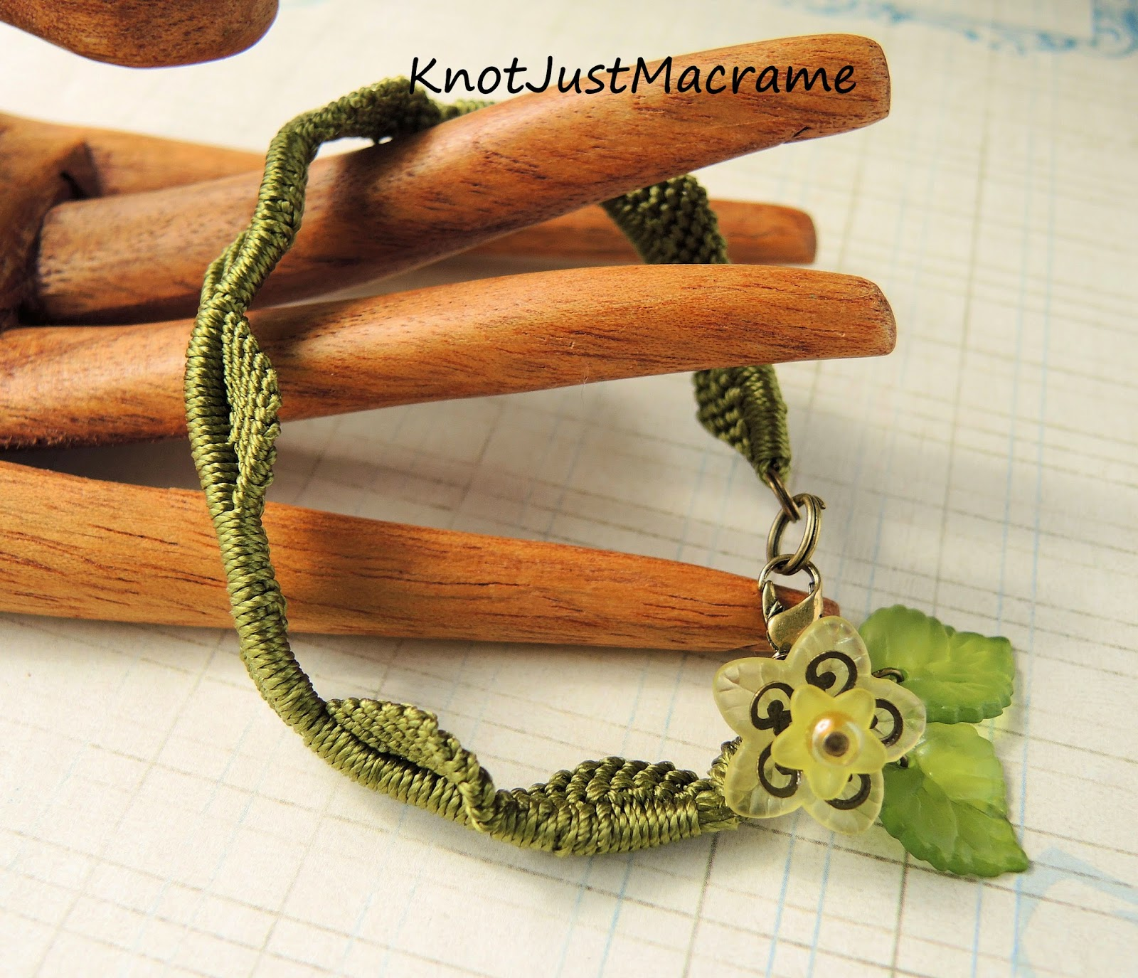 Leafy vine micro macrame bracelet design with lucite flower dangle.