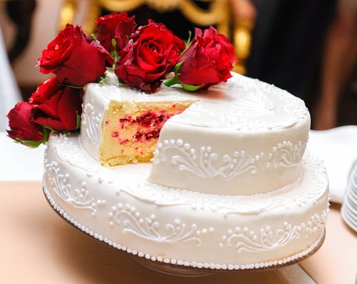 Wedding cake showing slice removed revealing filling