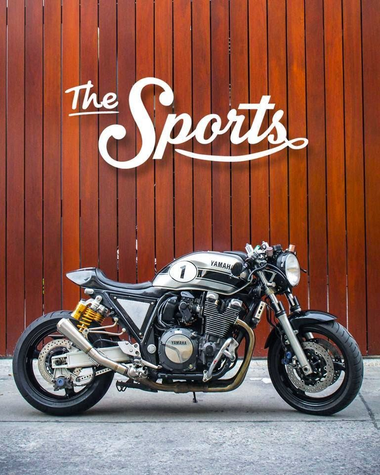 Yamaha XJR1300 Cafe Racer. Yamaha Cafe Racer by The Sports Custom based on a Yamaha XJR1300. Yamaha XJR1300 Cafe Racer looks extremely massive and sporty. Yamaha Cafe Racer conversion (Yamaha XJR1300 Cafe Racer) Yamaha Cafe Racer seat, Yamaha Cafe Racer tank, Yamaha XJR1300 clip on handle bar, Yamaha Cafe Racer rear set, Custom LED tail lamp, Yamaha Cafe Racer seat cowl, Custom LED turn signals, Custom motorcycle leather work, Custom Megaphone exhaust ( Cafe racer Exhaust), Custom bar end mirrors, The Sports Custom have always amazed us with their custom projects this Yamaha XJR1300 Cafe Racer is no exception.