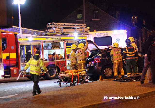 Manchester road outside Craven Heifer, RTC persons trapped
