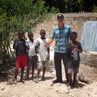 Mark Kirwin and four children at the unfinished primary school in Oranges de Bainet, Haiti