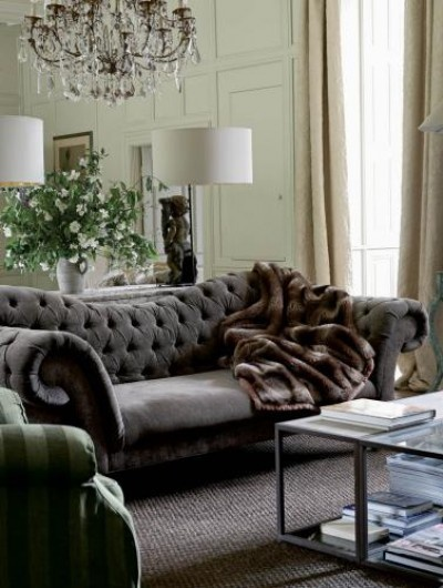 gray velvet tufted couch sofa with mirrored wall