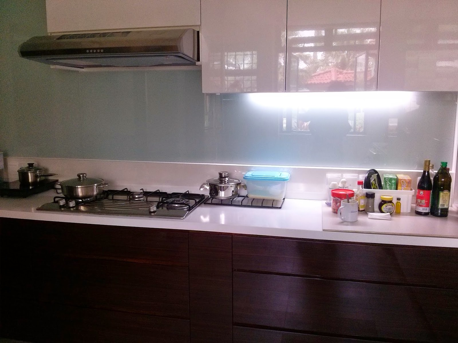 Singapore Interiors Design Hi Gloss Kitchen Cabinets Complete With Painted Glass Panels