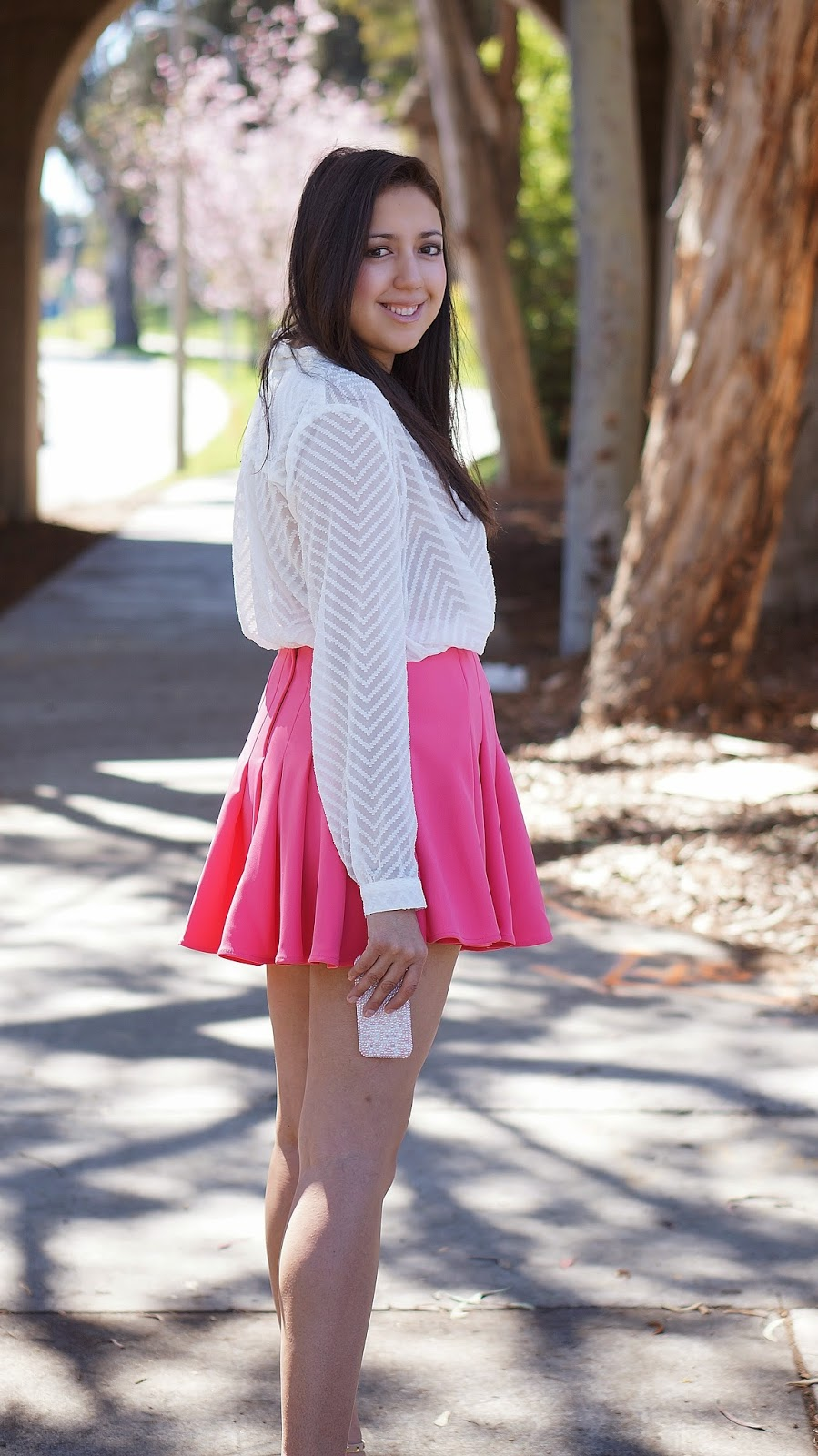 H&M pink pleated skirt. Bisou Bisou white twist neck top. Valentino Inspired heels