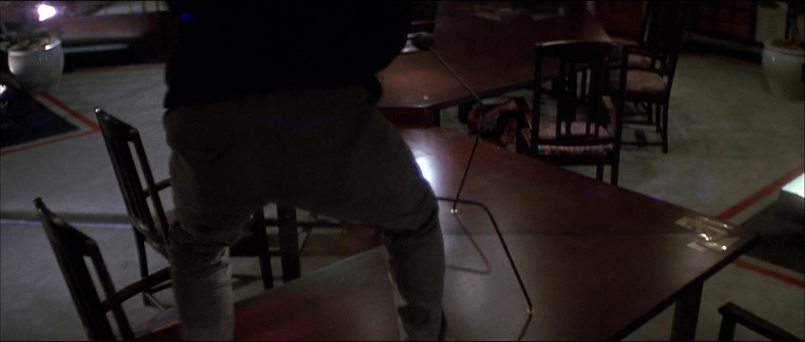 Die Hard Bruce Willis film 1988 John McClane table terrorist shooting scene screenshot