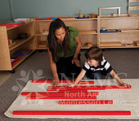 NAMC montessori teacher and child work with red rod sensorial material follow the child help autism