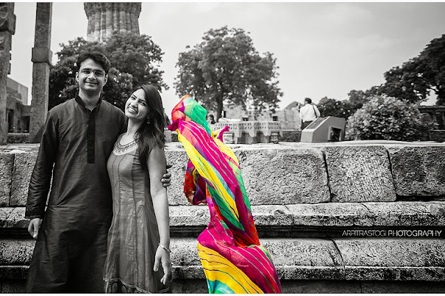 This is my photo journey to an outdoor couple shoot in DelhiMy friend booked me for her best friend's wedding, so basically this shoot was a wedding gift to the couple and it was fun working with them.We started off with India Gate, you don't have much location issues when you are in the capital of India itself. So here I got my album cover shot for this pre-wedding shootMoving on next, I wanted to add something more dynamic to the shoot so we tried dupatta shot and it was tough getting it right at first but we pulled it off after n'th number of tries. Here are few dupatta shots from the shootMixing it up in post processing and got this as random output and I felt really good about this shot, it made me believe in the power of photoshop with a pinch of luck becauge of how it gave almost another dimension and meaning to this otherwise simple photograph and I was plain lucky to get it rightWe went to the auto-rickshaw wale bhaiya next, for the permission to use their auto as a prop and he was more than happy to grant his permission for the same.This photo is clicked by Sachin who was assisting me on this shoot and it came out real well. I, in particular loved the minimalistic nature of itAnother auto-rickshaw shot with my wide angle lens,We left from here with few good shots and headed for Qutub Minar. Now that we get the hang of dupatta shot so we started off with dupatta again but this time it was Qutub Minar in the background,Next we tried the walk to remember shoAnother shot with the symmetrical pillars and alternate focus on the couplPutting my wide angle lens to good use, couple with the amazing background of mughal architecturWe were done doing our shoot in traditional style, so it was time to go casual and we headed for Hauzkhas Village nextNow all the following photos are from the colorful streets of Hauzkhas village but still Classics happen in black and whites, so here is one classic from the shootNow paint some colors, shall we? What about Yellow with some happiness? That would make the world better place, no? Here is all colorful shot from the streeWhat could be more colorful than that? Let's see another shot with the graffiti in backdroNow we tried another shot with their mobile phones and handmade badtameej dilIt was time to wrap up the shoot because everybody was tired of all the posing and shooting stuffMy very best wishes to this beautiful couple and hope that one day when they will look back to this day they will find it in one of their happiest days.