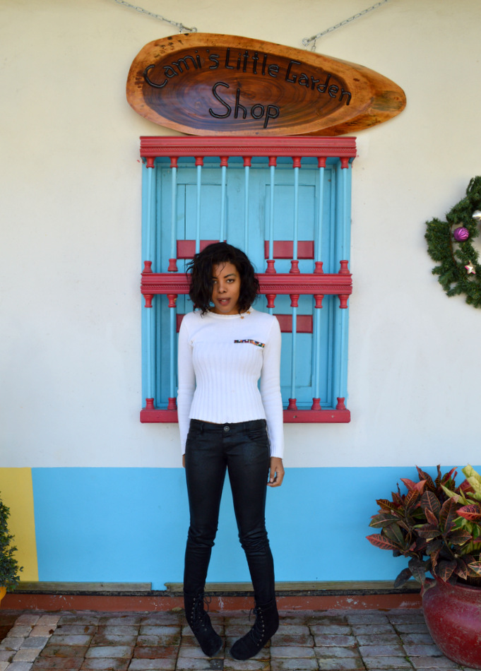Fashion Blogger Anais Alexandre of Down to Stars in a vintage zara military sweater, jolt leather pants and forever 21 black combat boots in a mexican puebla village in homestead florida