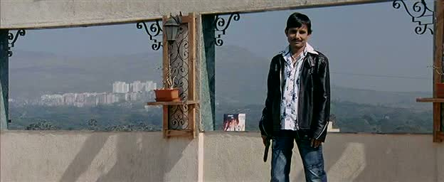 KRK smiling like a creepy stalker