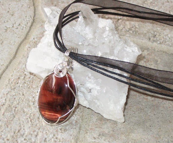 https://www.etsy.com/listing/187955267/red-tigers-eye-crystal-cabochon-wire?ref=shop_home_active_1
