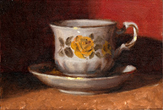 Oil painting of a Queen Anne teacup and saucer with a yellow rose pattern, both in front of a red background.