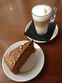 Latte and a slice of coffee and walnut cake