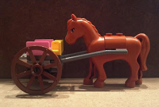 lego horse with a cart in front of it