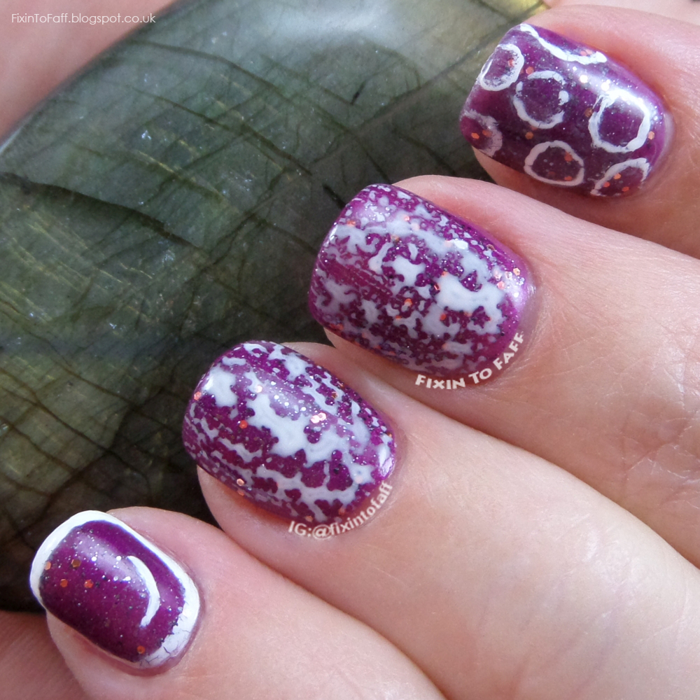 Purple and white bubble nail art manicure.