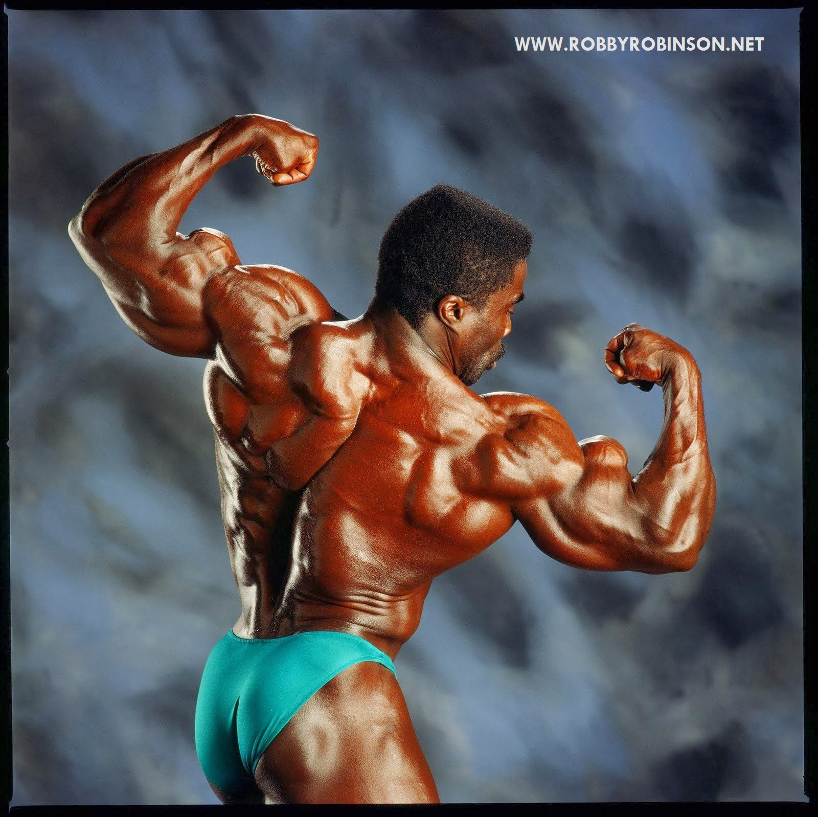 ROBBY ROBINSON BY MIKE NEVEUX FOR IRON MAN MAGAZINE - REAR DOUBLE BICEPS CURLS ● www.robbyrobinson.net//anabolic-pack.php ●