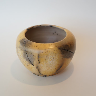 Beautiful handmade horsehair and feather raku pottery vase by Lily.