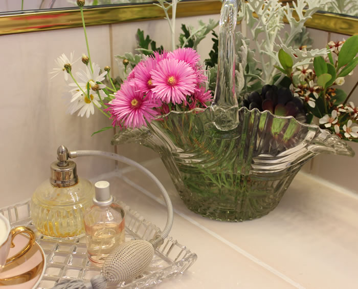 A Basket of Beauty in the Bathroom flowers crystal perfume