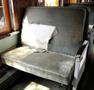 coach seat with torn seat cover