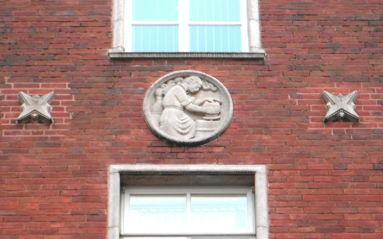 Roundel on The Lancaster Building in Newcastle under Lyme