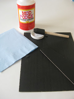 frame back, blue napkin, decoupage glue and sponge brush