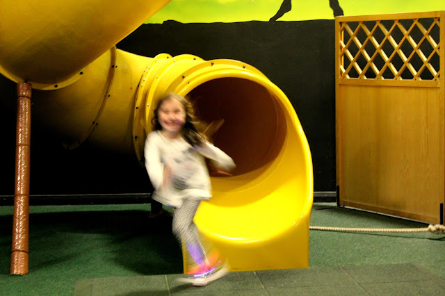 kid excitedly exiting slide fastly