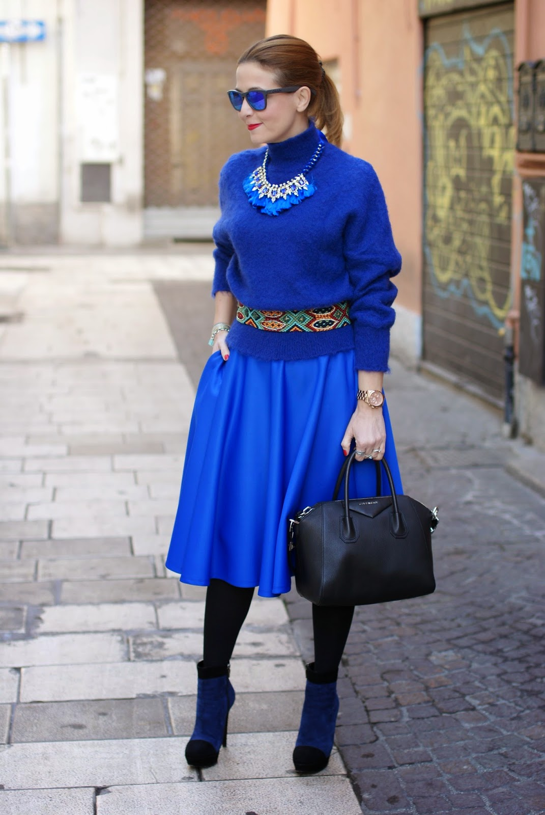 royal blue midi circle skirt, turtleneck sweater with tassel necklace, Fashion and Cookies, fashion blogger