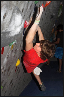 Davis Stewart climbing at Aiguille Rock Climbing Center