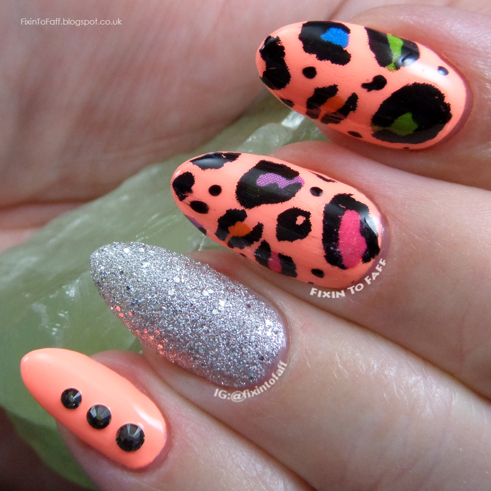 Birthday nail art of neon leopard print and black diamond swarovski crystal accents.