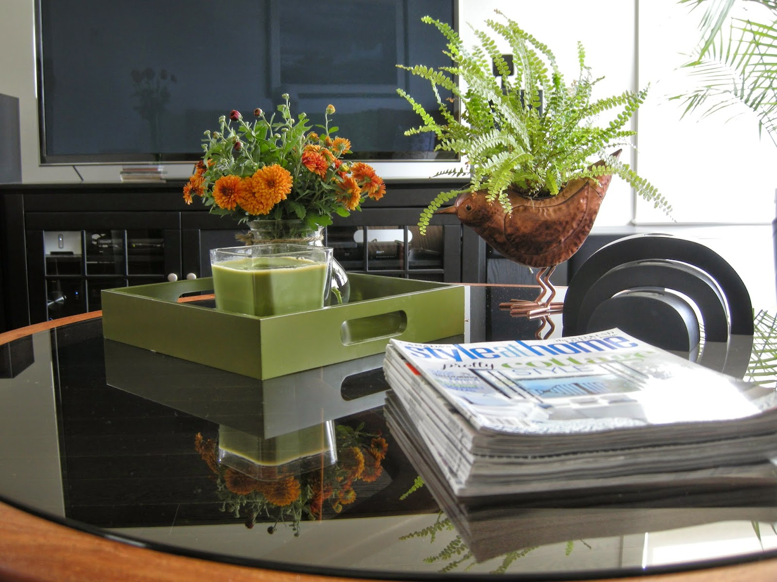 coffee table vignette, fern, copper bird planter, green tray